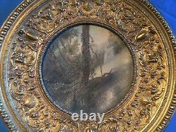 Tableau peinture huile paysage rond ancien entouré dun cadre en bronze